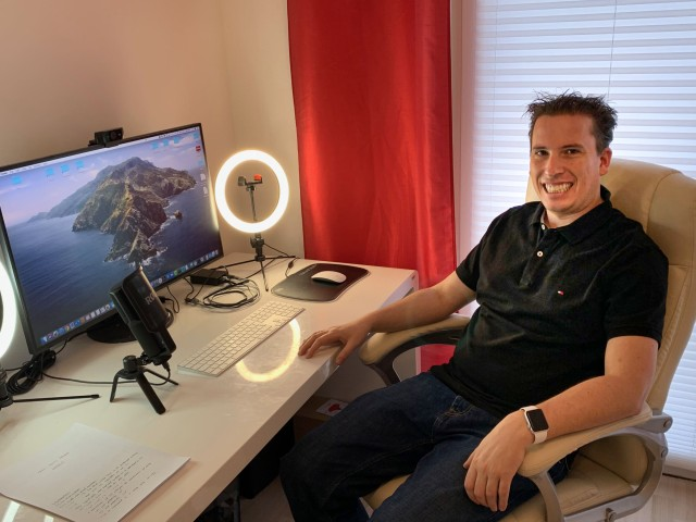 Kai Müller sitting at his desk working from home office.