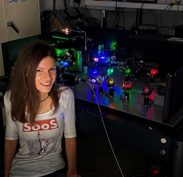 Lina Todenhagen sitting next to her experiments in the laboratory at WSI.
