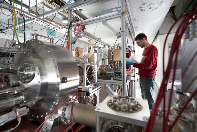 Scientists working in a Quantum Dynamics laboratory.